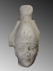 Marble head of Osiris wearing the Atef crown
